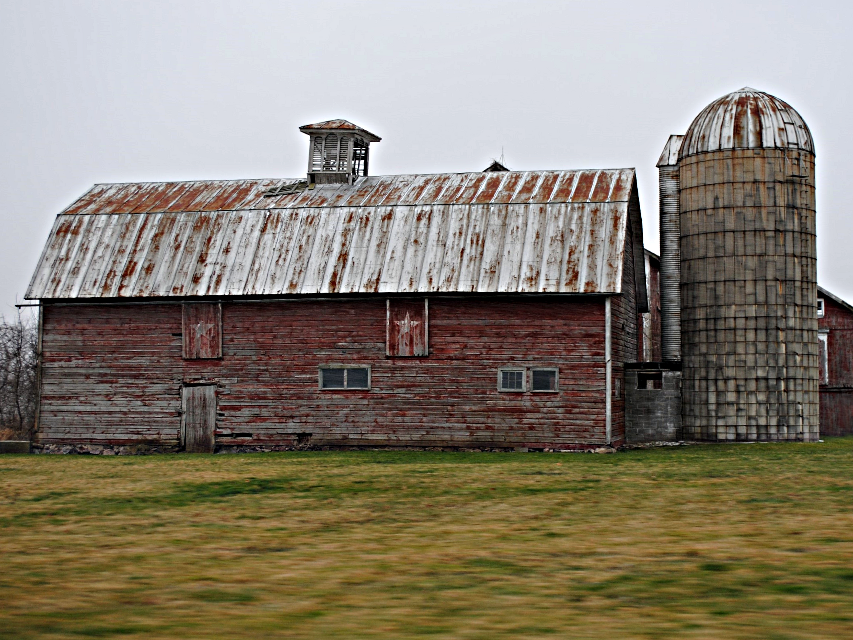 """""""The old and the older series"""" These barns photos were taken while riding in a car. I like the movement surrounding them, and cant believe I caught so many on the move!  I have a soft spot in my heart for old barns. #photography #barn #rural #movement #photowhilemoving #snow #snowing #HDR"""