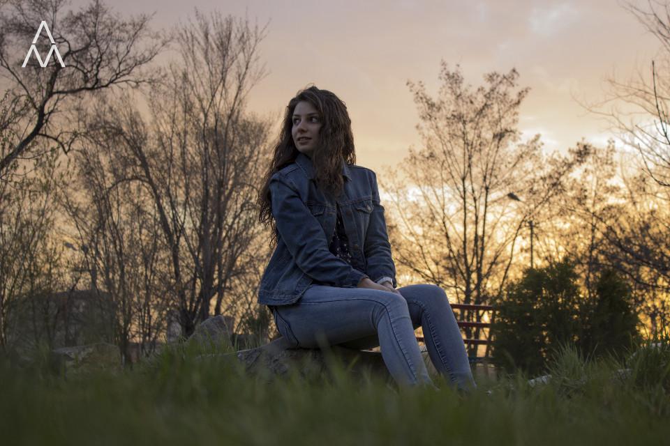 Waiting... #park #trees #branches #stones #sundown #grass #greengrass #sky #clouds #girl #sunset