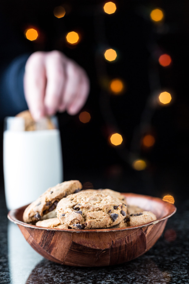 Bowl of Cookies with Milk in the Background  Check out my blog: www.fotoinusgrobler.com  Follow on Instagram @fotoinusgrobler   The bowl of cookies was lit from the left side with a softbox and a white reflector from the right. The small blurred lights in the background is christmas lights.   This photo was taken in June 2013 with a Canon 5D MkIII with Canon EF 50mm f/1.4 USM.   Camera settings: f/4.0, 1/60 and ISO 200.   #cookies #milk #studio #microstock #softbox #photooftheday #photography #kitchen #food #foodphotography