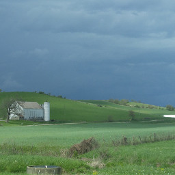 farm farmhouse barn hillside stormclouds